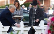 Trump visits synagogue shooting victims amid protests
