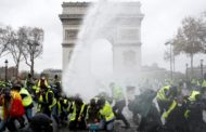 Tear gas fired, hundred arrested at 'Yellow Vest' protests in Paris