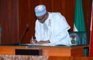 Buhari signs N30,000 Minimum Wage