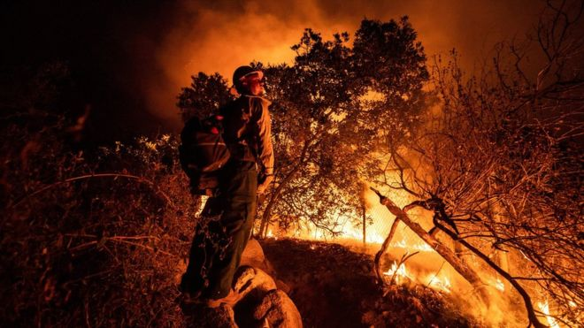 US West Coast fires: Row over climate change's role as Trump visits